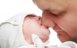 newborn baby sucking father nose