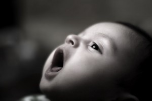 Nice small baby looking and yawns