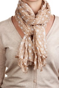 Woman wearing scarf close up