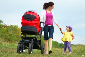mother with little daughter and pram